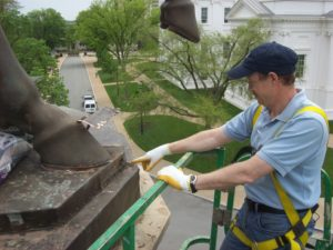 Farmer examining the statue plinth flashing installation at the George Washington Equestrian Monument in Richmond, VA.