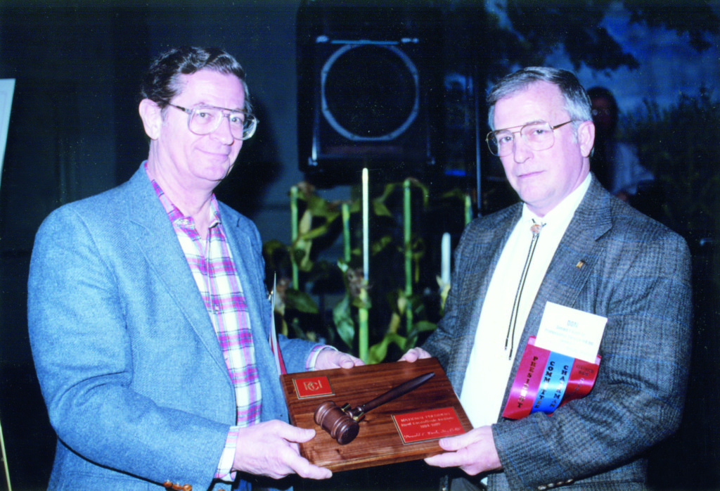 Don passes the president's gavel to Dick Horowitz in 1992.