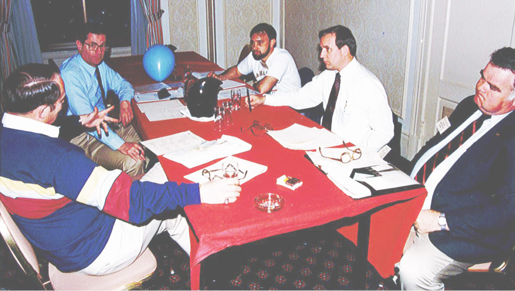 Don Bush (second from right) and others discuss RCI business, 1996. Left to right: Bob Martin, Dick Horowitz, Warren French, Don Bush, and Joe Hale.