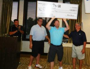 three guys with big check