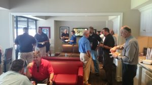 Attendees mingle and socialize during the game.