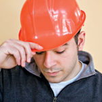 Sad construction worker