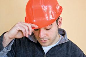 Sad construction worker