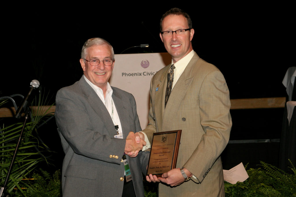 Don receives the Outstanding Volunteer Award at the 2006 convention from President Tom Hutchinson.