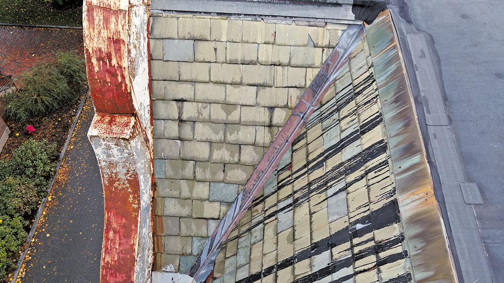 damaged sloped gable slate roofs