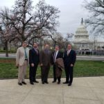 Five RCI leaders standing in front of the Capitol