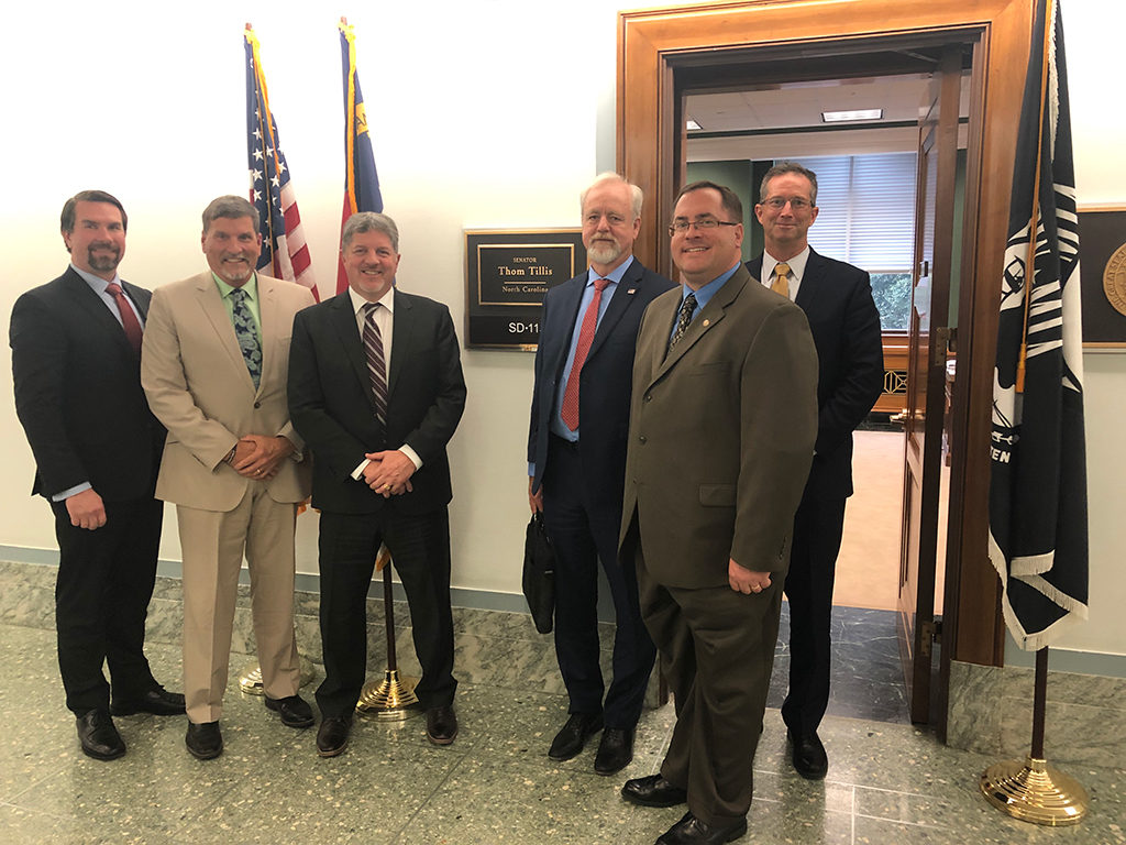 Photo of six IIBEC leaders in front of Thom Tillis' office.