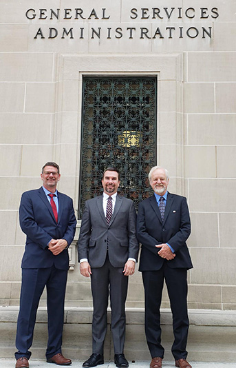 three guys in front of gsa building