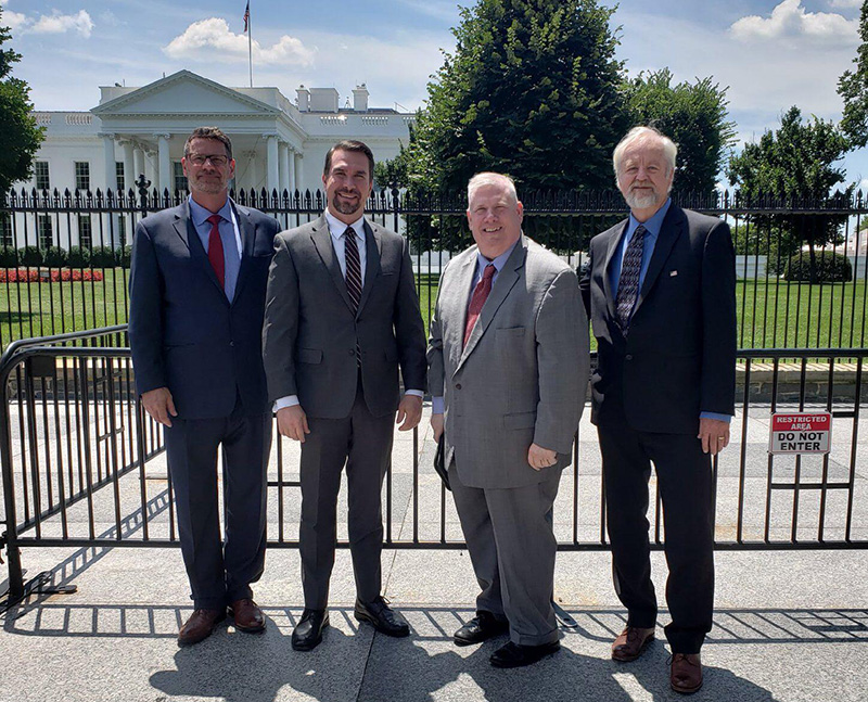 four guys in front of capitol building