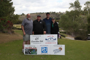 four golfers with sponsor signs