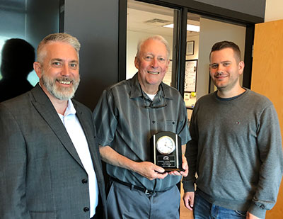 Wells accepts RCABC honor.